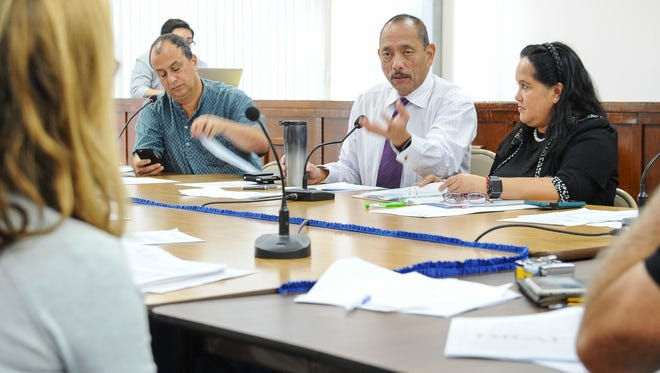 Vice Speaker Benjamin J. Cruz, center, responds to an question by independent consultant Roisin Wade during a roundtable meeting at the Guam Legislature on Thursday, May 12. The meeting was held to discuss regulations rules and regulation regarding the operation of a bed and breakfast on Guam.