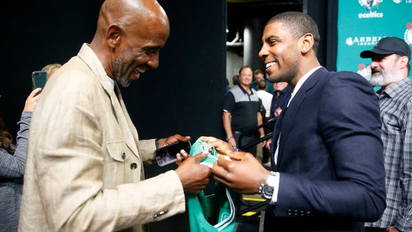 e5aa427f0 Kyrie Irving gives dad his first Celtics jersey
