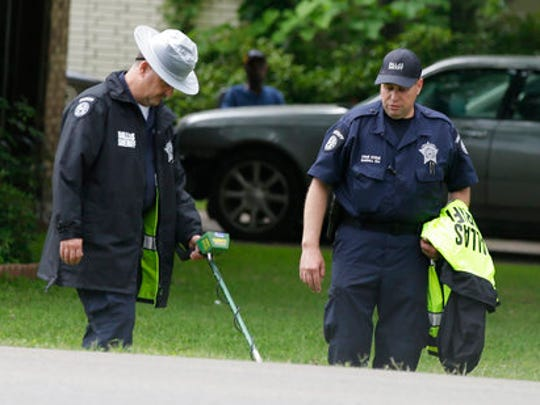 Dallas County Sheriff crime scene investigators use a metal detector at the intersection near where Jordan Edwards was killed by a police officer in Balch Springs, Texas, Wednesday, May 3, 2017. As the family of the black teenager slain by a white police officer calls for an indictment and more investigation, the Dallas suburb where he died faces some of the same issues with race as Ferguson, Cleveland, and other cities that have experienced high-profile police shootings of African-Americans.