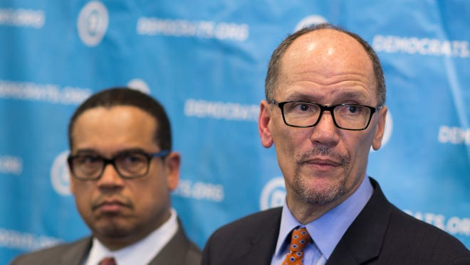Newly elected Democratic National Committee Chairman Tom Perez (right) and U.S. Rep. Keith Ellison, D-Minn., who was named deputy chairman, listen to a question from the media during a press conference at the DNC winter meeting in Atlanta on Saturday.