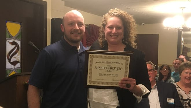Ahnapee Brewery head brewmaster Nick Calaway receives the Industry Award from Algoma Area Chamber of Commerce Director Sara Krause at the chamber's Business Industry and Education Awards banquet,