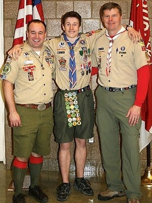 Denver Laabs, Great Lakes Field Service Council (left) and former Troop 755 Scoutmaster, Chris McCormick (right) flank Kevin Morris.