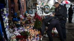 New York police pay respects on Dec. 23, 2014, at the