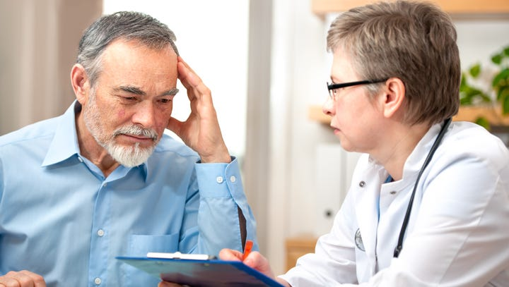 Male patient tells the doctor about his health complaints.