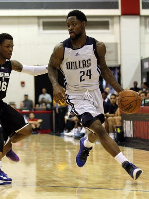 Jul 13, 2013: Dallas Mavericks guard Terrico White dribbles the ball around Sacramento Kings guard Ben McLemore during the second half of an NBA Summer League game at Cox Pavillion.