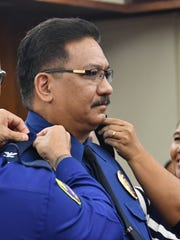 Former senator Mark Charfauros is promoted to the rank