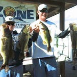Kyle Walters, right, and his 14-year-old son Andrew won last year's Strike Zone Bass Trail championship worth $2,000 in cash. The championship for this year's trail is scheduled for May 7 on Lake Washington west of Melbourne. A field of 40 teams will compete.