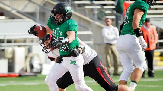 Eau Claire Regis' Caleb Brickner scores a touchdown