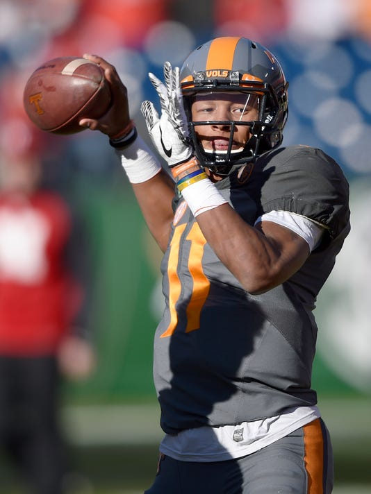 1bd6b3e854b Tennessee Volunteers quarterback Joshua Dobbs (11) warms up before the  Franklin American Mortgage Music City Bowl at Nissan Stadium in Nashville  on Dec.