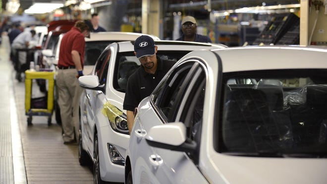Hyundai Motor Manufacturing Alabama workers build cars at the assembly plant in Montgomery.