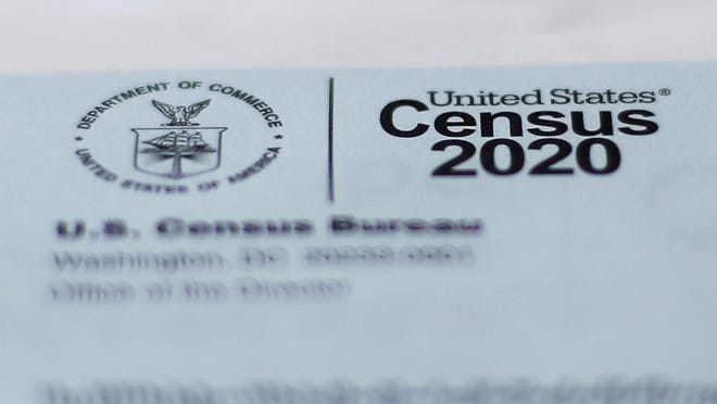 A 2020 census letter mailed to a U.S. resident, is shown in Detroit, Sunday, April 5, 2020. The Census Bureau is required by federal statute to send the president the counts that will be used to carve up congressional districts -- known as apportionment -- and draw state legislative districts by Dec. 31. The new coronavirus COVID-19 spread forced the U.S. Census Bureau to suspend field operations.