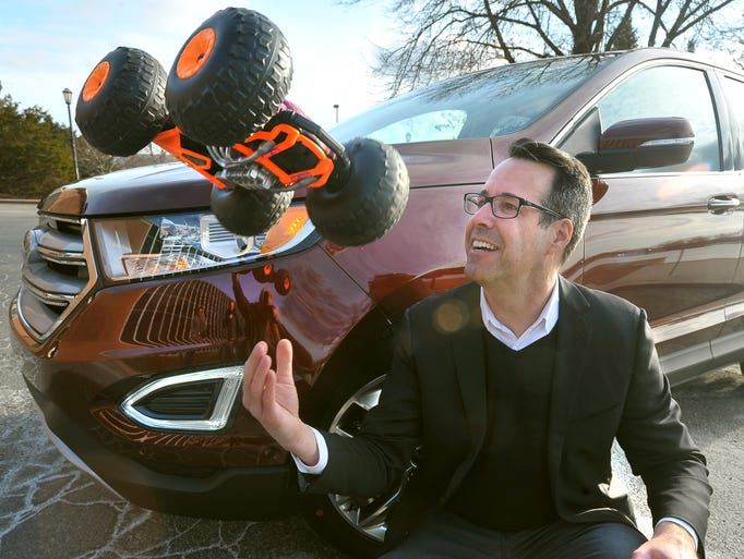 Ford car designer Kevin George with the 2015 Ford Edge