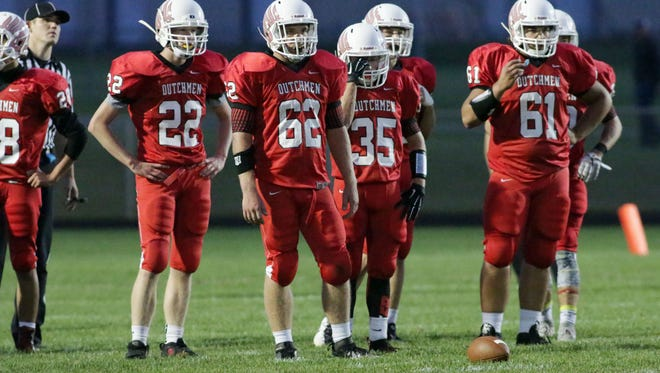 Oostburg players wait for action to restart against Manitowoc Lutheran Friday September 11, 2015 at Oostburg.