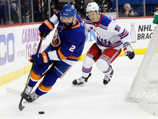 New York Rangers' Vladislav Namestnikov (90) fights for control of the puck with New York Islanders' Nick Leddy (2) during the first period of an NHL hockey game Thursday, April 5, 2018, in New York. (AP Photo/Frank Franklin II)