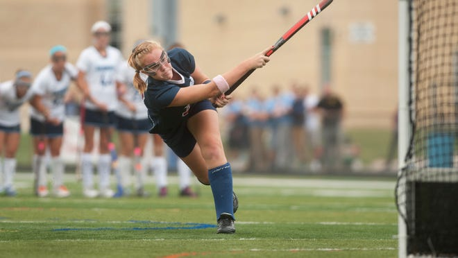 Eastern's Austyn Cuneo shoots and scores during a penalty stroke in the 1st half of Thursdays field hockey game between Eastern and Shawnee played at Shawnee High School.  10.02.14