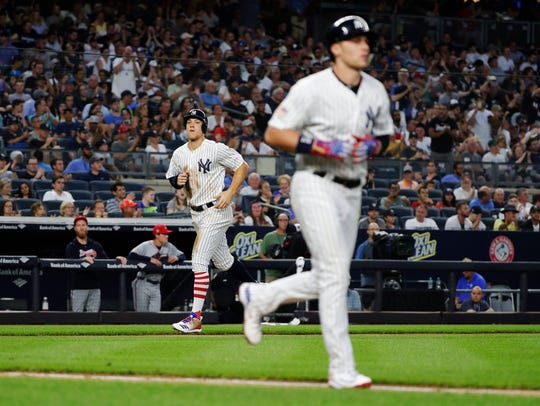New York Yankees' Aaron Judge, left, heads to home