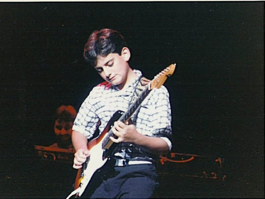 Even as a youngster, Brad Paisley was unafraid to take a guitar solo. In this undated photo, he is shown performing in West Virginia.