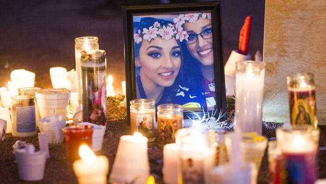 Candles are set around a picture for Jovanna Martinez-Calzadillas during a candlelight vigil at Hayden High in Winkelman, Ariz. on Oct. 8, 2017. Jovanna was critically injured in the Las Vegas shooting.