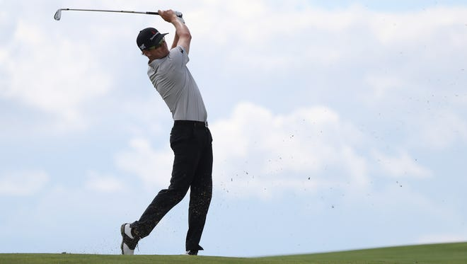Jun 18, 2017; Erin, WI, USA;  Zach Johnson plays his shot from the eighth fairway during the final round of the U.S. Open golf tournament at Erin Hills. Mandatory Credit: Geoff Burke-USA TODAY Sports
