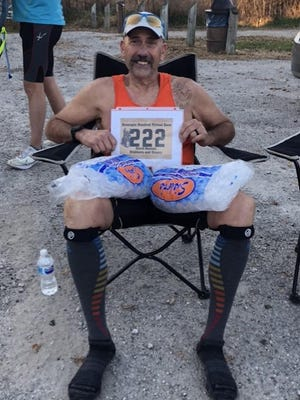 David Benson of Galva relaxes after completing  the Hennepin Hundred ultramarathon.