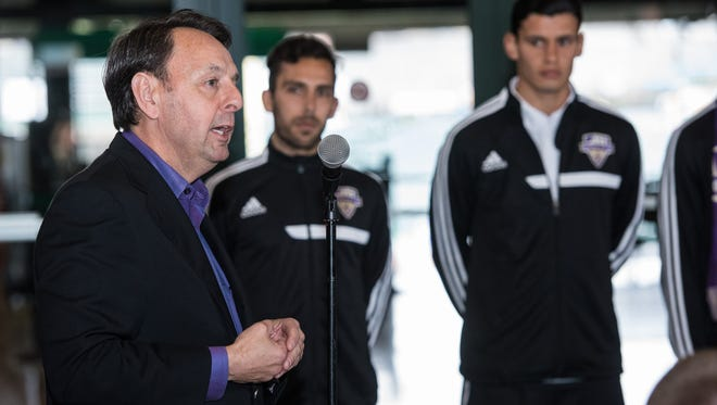 Louisville City FC professional soccer team owner Wayne Estopinal answers questions during an unveiling of the team's new kit for fans gathered at Louisville Slugger Field in downtown Louisville where the team will play their home matches. Mar. 26, 2015