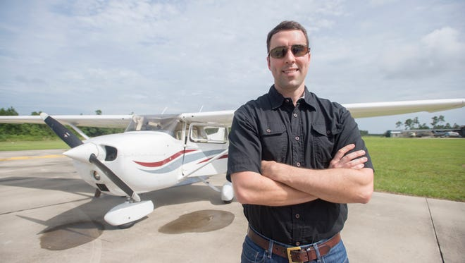 Kilton Kingsman, who has been named Angel Flight Southeast's Pilot of the Year, stands for a photo on Thursday, June 1, 2017, in Pensacola. Kingsman is a newly promoted lieutenant commanderin the U.S. Naval Reserve and flight instructor at Pensacola Naval Air Station.