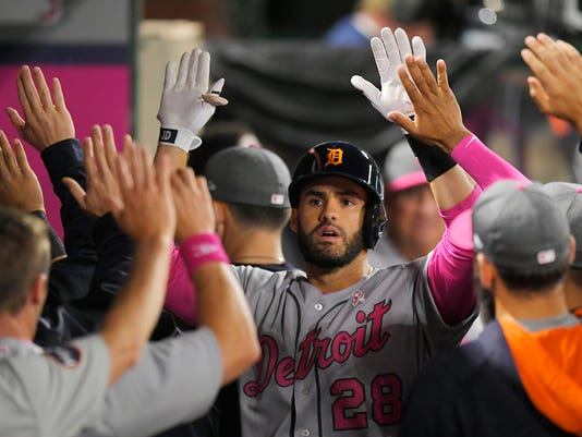 Detroit Tigers' J.D. Martinez is congratulated by teammates after hitting a solo home run during the ninth inning of the team's baseball game against the Los Angeles Angels, Saturday, May 13, 2017, in Anaheim, Calif. (AP Photo/Mark J. Terrill)