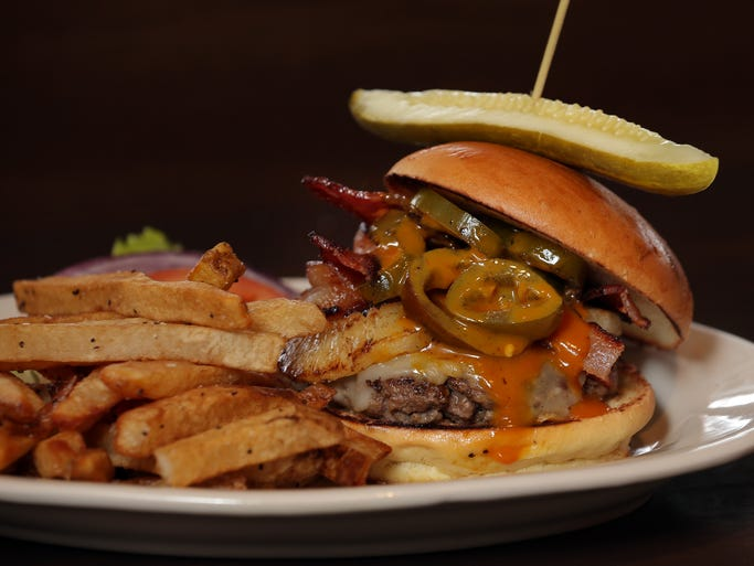 The None the Wiser Burger at 317 Burger is <p>topped with jalapenos, pineapple, bacon and barbecue sauce. The name refers to the restaurant's bar.</p>