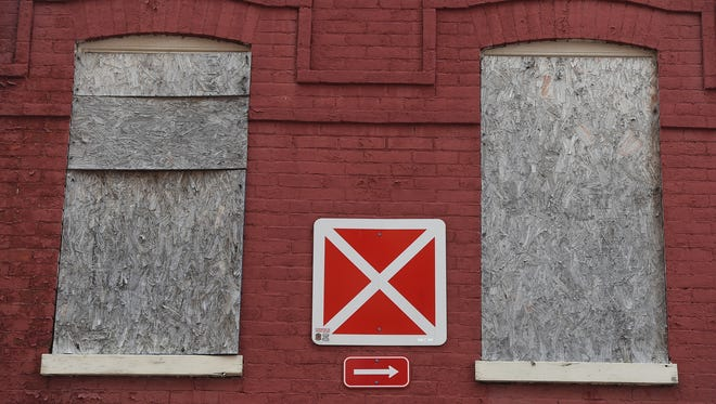 An X sign is located between two windows at 22 West Boundary Ave. in York. The city fire department's no entry program is marked on buildings with this sign. It means firefighters are not supposed to enter the buildings when they catch fire.