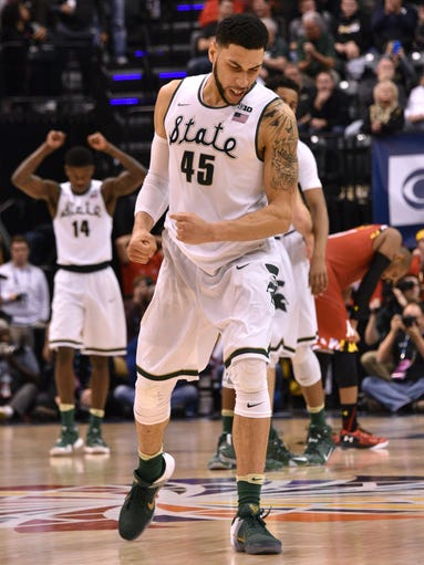 Denzel Valentine and the Michigan State Spartans celebrate