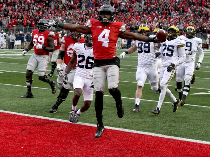 Ohio State's Curtis Samuel jumps for joy and into the