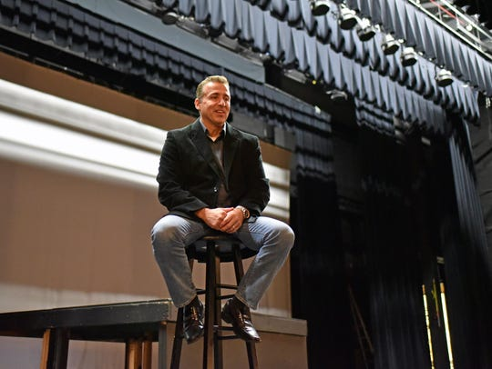 Musician Emo Luciano sits on the stage at Landis Theater.