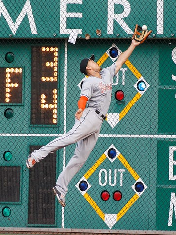 Giancarlo Stanton of the Miami Marlins catches the