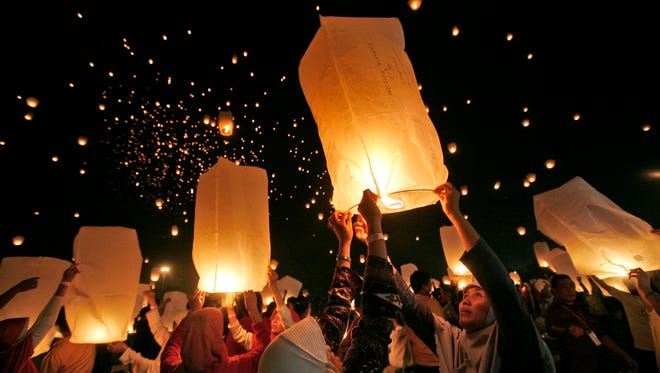 Residents of Jakarta, Indonesia, attempt to break a world record for the most sky lanterns flown simultaneously in 2009.