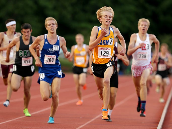 Carmel's Ben Veatch holds off the field to finish second in the 3200 meter run during the 111th annual Boys Track & Field State Finals, Saturday, June 7, 2014, at Indiana University's Robert C. Haugh Track & Field Complex.