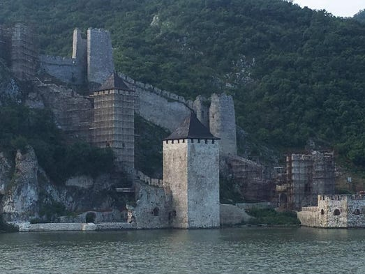 Cars drive through this fortress that is undergoing