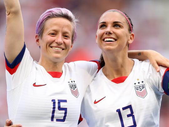 LYON, FRANCE - JULY 07:  Megan Rapinoe of the USA celebrates with teammate Alex Morgan after winning the 2019 FIFA Women's World Cup France Final match between The United States of America and The Netherlands at Stade de Lyon on July 07, 2019 in Lyon, France. (Photo by Richard Heathcote/Getty Images) ORG XMIT: 775320146 ORIG FILE ID: 1160608564