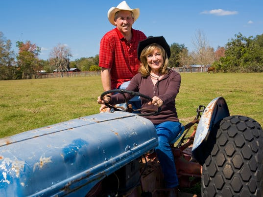 Mature Farm Couple on Tractor