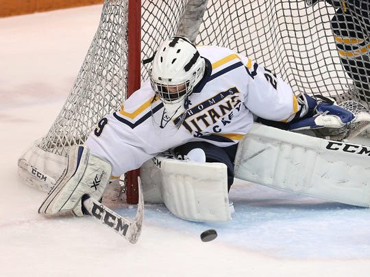 Thomas goalie Cody Rougeux makes a save against Victor.