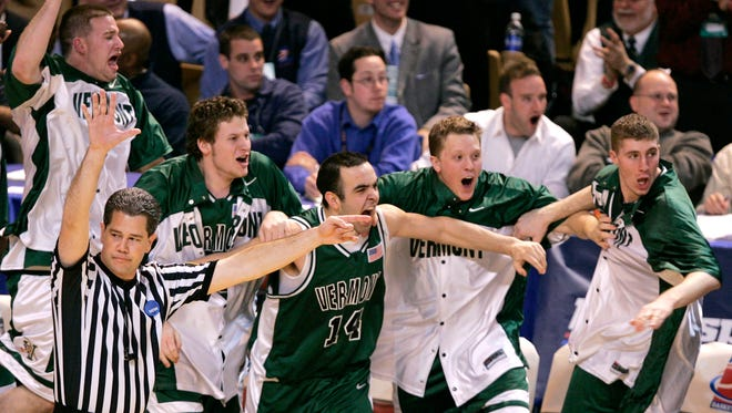 The Vermont bench reacts with excitement after beating Syracuse, 60-57, in their first round NCAA tournament game against Syracuse at the DCU Center on Friday, March 18, 2005, in Worcester, Mass.