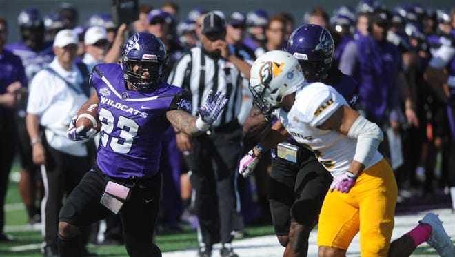 ACU running back Tracy James (23) runs for a 19-yard touchdown in the second quarter against Southeastern Louisiana. The score cut the Wildcats' deficit to 14-10 with 9:19 left in the half. The Lions won the game 56-21 on Saturday, Oct. 21, 2017 at Wildcat Stadium.