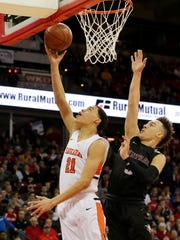 Kaukauna's Donovan Ivory goes in for a layup past Westosha Central's Jaeden Zackery during a WIAA Division 2 boys basketball state semifinal game March 16 at the Kohl Center in Madison.