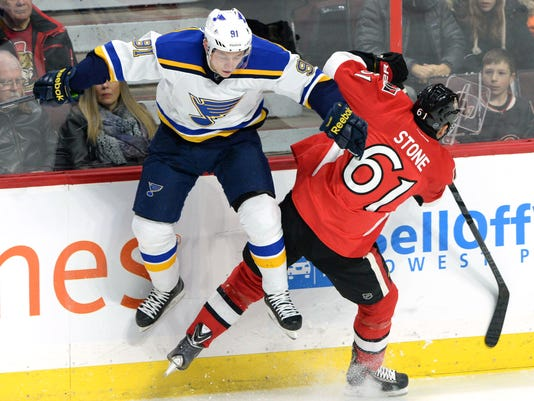 St. Louis Blues' Vladimir Tarasenko jumps out of the way from a hit by Ottawa Senators' Mark Stone during an NHL hockey game, Saturday, Nov. 22, 2014, in Ottawa, Ontario. (AP Photo/The Canadian Press, Sean Kilpatrick)