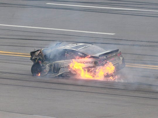 Danica Patrick's car burns after her crash with driver Matt Kenseth during the GEICO 500 at Talladega Superspeedway.