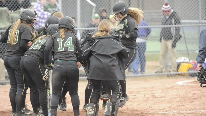 Oshkosh North's Jorddyn Dedering (17) jumps in the air as she gets to come plate after hitting a three-run home run during a seven-run second inning against Fond du Lac on Tuesday.