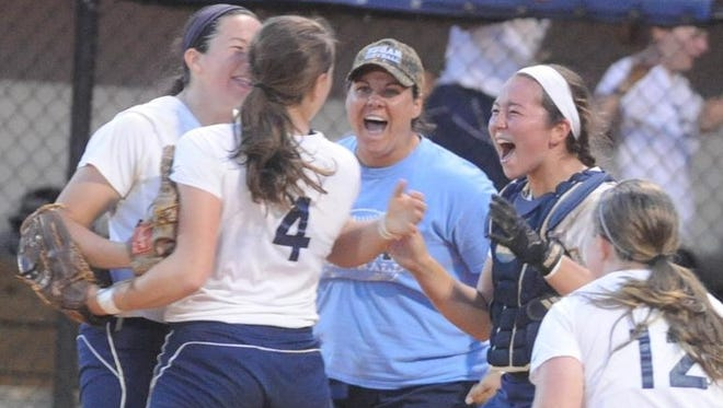 Enka players and Jennifer Kruk celebrate after Friday's final out in  Candler.