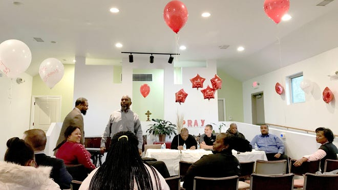 At a meeting, Brightmoor Homes residents tied red balloons to chairs with complaints written on them.