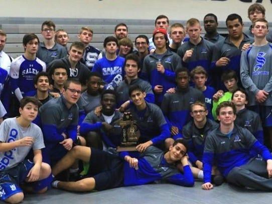 Salem's varsity wrestling team celebrates after winning