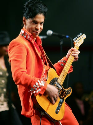 Prince performs during the Super Bowl XLI halftime press conference in 2007 with a custom guitar inspired by the Fender Telecaster Green Bay musician Jimmy Crimmins sold him in 1981 in Los Angeles.