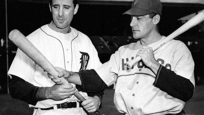 Detroit Tigers Hall of Famer Hank Greenberg (left) poses with Cubs first baseman Phil Cavaretta before the 1945 World Series. Greenberg led the Tigers to the title.
